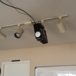 Projector with track lighting mount